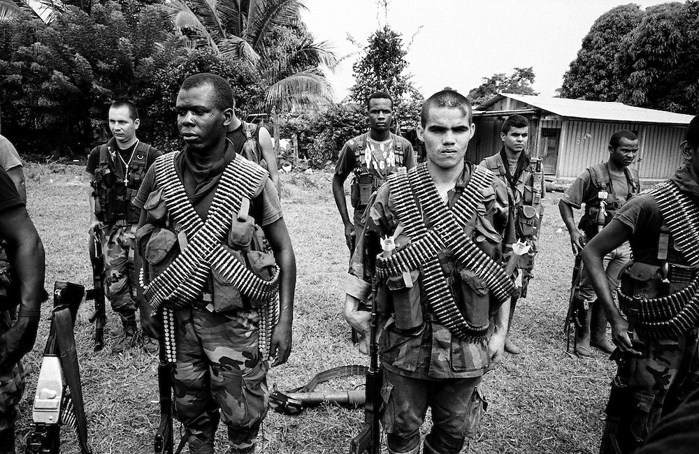 AUC fighters on parade in a village near La Dorada, Putumayo.<br />