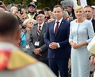 Poland President Andrzej Duda (center) and his wife Agata Kornhauser (right) watch as a priest blesses the monument at the memorial Tomb of Fallen Soldiers killed by Communists from 1944-63 Sunday, September 18, 2016 in New Britain, Pennsylvania.  (Photo by William Thomas Cain)