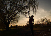 Cheyenne Johnson, 21, hula hoops at Seneca Lake State Park in Geneva, NY, Thursday, May 14, and Sunday, May 17, 2015.<br /> (Heather Ainsworth for The Syracuse Post-Standard)