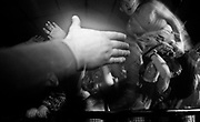 A crowd surfer is offered a hand over the barrier in front of the stage. W. Australia 1990's.