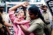 BANGALORE,1999.<br /> A student is arrested during a protest rally organised by Students Federation of India, in the Indian city of Bangalore. Students were protesting against the hike in college fee by the state government.