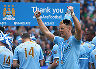 Joe Hart of Manchester City celebrates winning the  Barclays Premier League at the Etihad Stadium, Manchester<br /> Picture by John Rainford/Focus Images Ltd +44 7506 538356<br /> 11/05/2014