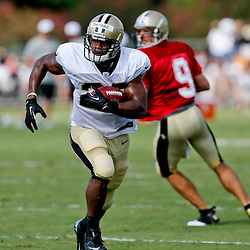 Aug 3, 2013; Metairie, LA, USA; New Orleans Saints running back Pierre Thomas (23) runs with the ball during a scrimmage at the team training facility. Mandatory Credit: Derick E. Hingle-USA TODAY Sports