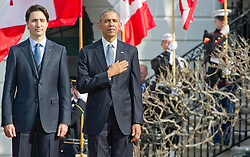 United States President Barack Obama, right, and Prime Minister Justin Trudeau of Canada, left, listen to the National Anthems during an Arrival Ceremony on the South Lawn of the White House in Washington, DC on Thursday, March 10, 2016. Credit: Ron Sachs, CNP - NO WIRE SERVICE -. EXPA Pictures © 2016, PhotoCredit: EXPA/ Photoshot/ Ron Sachs<br /> <br /> *****ATTENTION - for AUT, SLO, CRO, SRB, BIH, MAZ, SUI only*****