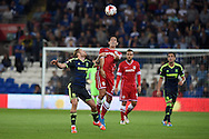 Peter Whittingham of Cardiff city &copy; heads the ball. Skybet football league championship match, Cardiff city v Middlesbrough at the Cardiff city stadium in Cardiff, South Wales on Tuesday 16th Sept 2014<br /> pic by Andrew Orchard, Andrew Orchard sports photography.