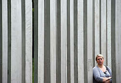© London News Pictures. 07/07/2012. A member of the public walking through the memorial to the victims of the July 7, 2005 London bombings in Hyde Park on July 7, 2012 in London. Today marks the 5 year anniversary of the terrorist attacks by four suicide bombers on the London Underground and a bus in Tavistock Square which claimed the lives of 52 people.  Photo credit: Ben Cawthra/LNP.