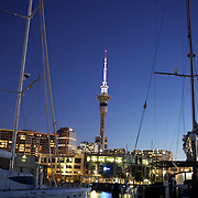 Moored yachts in Viaduct Basin showing Sky Tower in the background. Auckland, New Zealand. <br /> Located in the heart of Auckland City, Viaduct Basin and Harbour is a first class residential, commercial and entertainment precinct..The marina caters to commercial vessels, pleasure craft and super yachts with 150 marina berths ranging in size up to 60 metres..Viaduct Basin hosts many fabulous events including the past America's Cup defences, Louis Vuitton Regattas, the Volvo Round the World Race stopover, Auckland International Boatshow and New Zealand Fashion Week..Visitors can explore New Zealand's rich maritime history at Voyager Maritime Museum, cruise the harbour on a charter yacht, view the yachts berthed in the harbour and enjoy the world class hospitality at the many bars and restaurants that line the waters edge..New Zealand's largest marine service precinct, Westhaven, lies a short walk to the west.. Auckland, New Zealand. 7th November 2010. Photo Tim Clayton