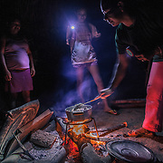 Preparing a soup at night in the community of Coece