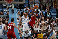 CHAPEL HILL, NC - JANUARY 27: Markell Johnson #11 of the North Carolina State Wolfpack is defended by Joel Berry II #2 of the North Carolina Tar Heels on January 27, 2018 at the Dean Smith Center in Chapel Hill, North Carolina. North Carolina lost 95-91. (Photo by Peyton Williams/UNC/Getty Images) *** Local Caption *** Markell Johnson;Joel Berry II