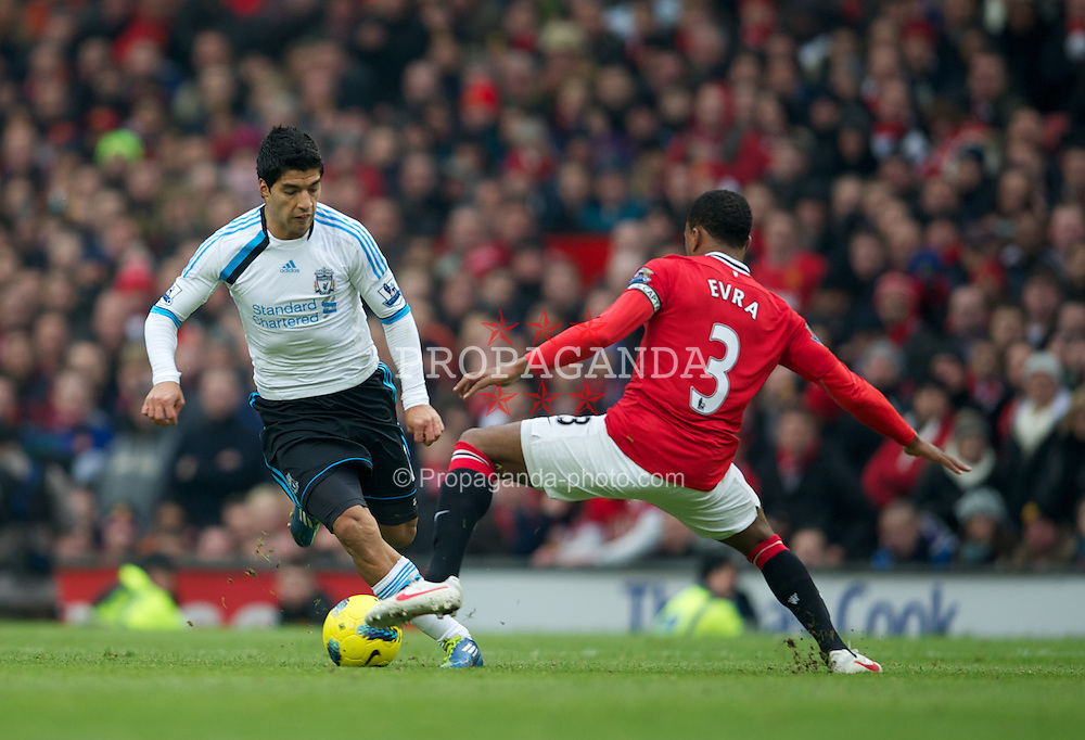 MANCHESTER, ENGLAND - Saturday, February 11, 2012: Liverpool's Luis Alberto Suarez Diaz dances past Manchester United's Patrice Evra during the Premiership match at Old Trafford. (Pic by David Rawcliffe/Propaganda)