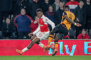 Moses Odubajo (Hull City) stops the ball running through to Alex Iwobi (Arsenal) during the The FA Cup fifth round match between Hull City and Arsenal at the KC Stadium, Kingston upon Hull, England on 8 March 2016. Photo by Mark P Doherty.