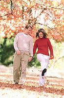Carefree Couple on a Walk --- Image by © Jim Cummins/CORBIS