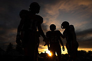 From left, Hanover's Roger Romany Walker (11), Hanover's Fabian Lara (22), and Hanover's Brett Noel (35) warm up before a football game between Hanover and Littlestown, Friday, Oct. 5, 2018, at the Sheppard-Meyers field in Hanover.