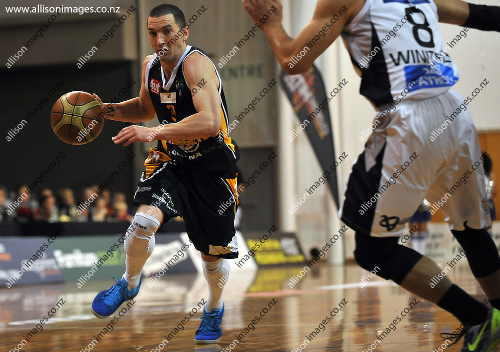 Mark Dickel runs up the court, in the NBL match, between the Otago Nuggets and Hawkes Bay, Lion Foundation Arena, Edgar Centre, Dunedin, Otago, New Zealand, Friday, May 24, 2013. Credit: Joe Allison / Allison Images.