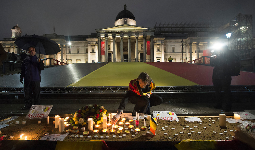 A member of the public lights candles during a vigil for the victims of the Brussels attacks in Trafalgar Square, Central London, Britain, 24 March 2016. At least 31 people were killed and 300 injured in explosions at Brussels airport and a Metro station on Tuesday 22 March according to Belgium officials. EPA/WILL OLIVER