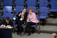 13 FEB 2009, BERLIN/GERMANY:<br /> Guido Westerwelle (L), FDP Bundesvorsitzender, und Angela Merkel (R), CDU, Bundeskanzlerin, im Gespraech, waehrend der Bundestagsdebatte zum zweiten Konjunkturpaket zur Sicherung von Beschaeftigung und Stabilitaet in Deutschland, Plenum, Deutscher Bundestag<br /> IMAGE: 20090213-01-068<br /> KEYWORDS: Gespräch