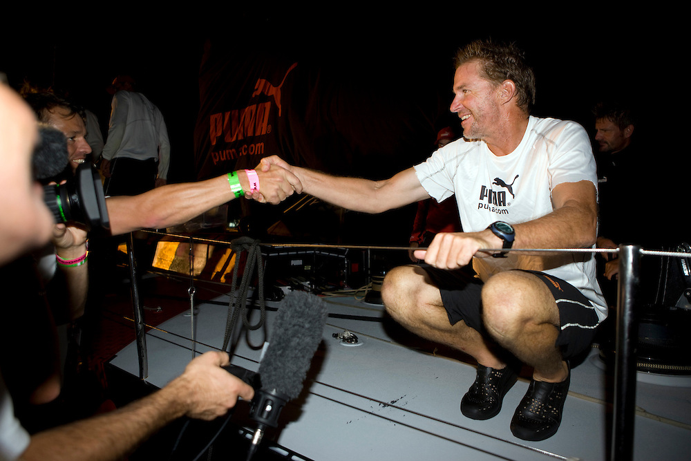 22DEC08. PUMA Ocean Racing dock in Singapore after cross the finish line at 23:08:01 local (15:08:01GMT), to finish leg 3 in 2nd place.  Volvo Ocean Race CEO Knut Frostad congratulates skipper Ken Read