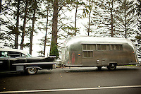 Vistors and sites at Devils Churn state park near Yachats, Oregon.A classic car pulls an airstream trailer.
