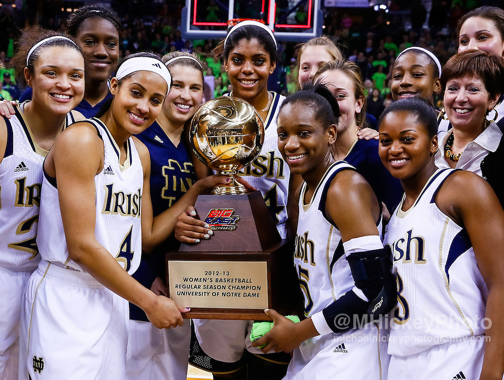 SOUTH BEND, IN - MARCH 04: Members of Notre Dame Fighting Irish pose with the Big East regular season trophy after defeating Connecticut Huskies at Purcel Pavilion on March 4, 2013 in South Bend, Indiana. Notre Dame defeated Connecticut 96-87 in triple overtime to win the Big East regular season title. (Photo by Michael Hickey/Getty Images)