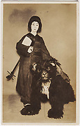 Male kabuki actor dressed as a geisha with actor dressed in a bear costume, 1920s, silver gelatin bromide.<br />