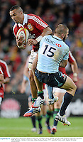15 June 2013; Simon Zebo, British & Irish Lions, is tackled by Drew Mitchell, NSW Waratahs. British & Irish Lions Tour 2013, NSW Waratahs v British & Irish Lions, Allianz Stadium, Sydney, NSW, Australia. Picture credit: Stephen McCarthy / SPORTSFILE