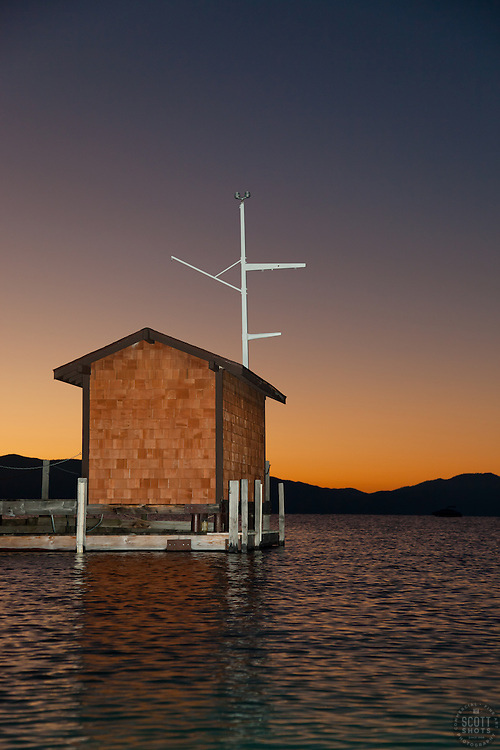 """Tahoe City Pier at Sunrise 3"" - This small building on the end of a pier was photographed at sunrise near Commons Beach, Lake Tahoe. Photographed from a kayak."