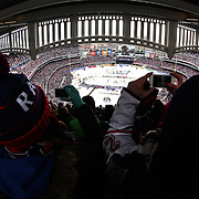 A panoramic view of Yankee Stadium as spectators take iPhone pictures during the New York Rangers Vs New Jersey Devils NHL regular season game held outdoors at Yankee Stadium, The Bronx, New York, USA. 26th January 2014. Photo Tim Clayton