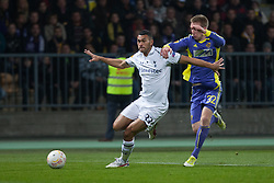 Steven Caulker #33 of Tottenham and Robert Beric #32 of Maribor during football match between NK Maribor (SLO) and Tottenham Hotspur FC (UK) in 3rd Round of Group Stage of UEFA Europa league 2013, on October 25, 2012 in Stadium Ljudski vrt, Maribor, Slovenia. (Photo By Gregor Krajncic / Sportida)