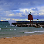 &quot;Charlevoix Lighthouse Storm&quot; 2<br /> <br />  The beautiful red lighthouse in Charlevoix Michigan during a storm with waves breaking against the pier!!<br /> <br /> Lighthouses of the Great Lakes by Rachel Cohen