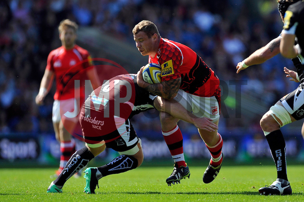 Koree Britton (London Welsh) takes on the Exeter defence - Photo mandatory by-line: Patrick Khachfe/JMP - Mobile: 07966 386802 06/09/2014 - SPORT - RUGBY UNION - Oxford - Kassam Stadium - London Welsh v Exeter Chiefs - Aviva Premiership
