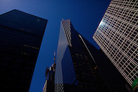 The Bank of America Tower (center) next to the Verizon Tower, left, and the HBO Building, right, at Bryant Park in New York.<br /> <br /> Photo by Robert Caplin