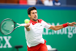 October 11, 2018 - Shanghai, China - Serbia's Novak Djokovic hits a return during the men's singles third round match against Italy's Marco Cecchinato at the Shanghai Masters tennis tournament on Oct. 11, 2018. Novak Djokovic won 2-0. (Credit Image: © Ding Ting/Xinhua via ZUMA Wire)