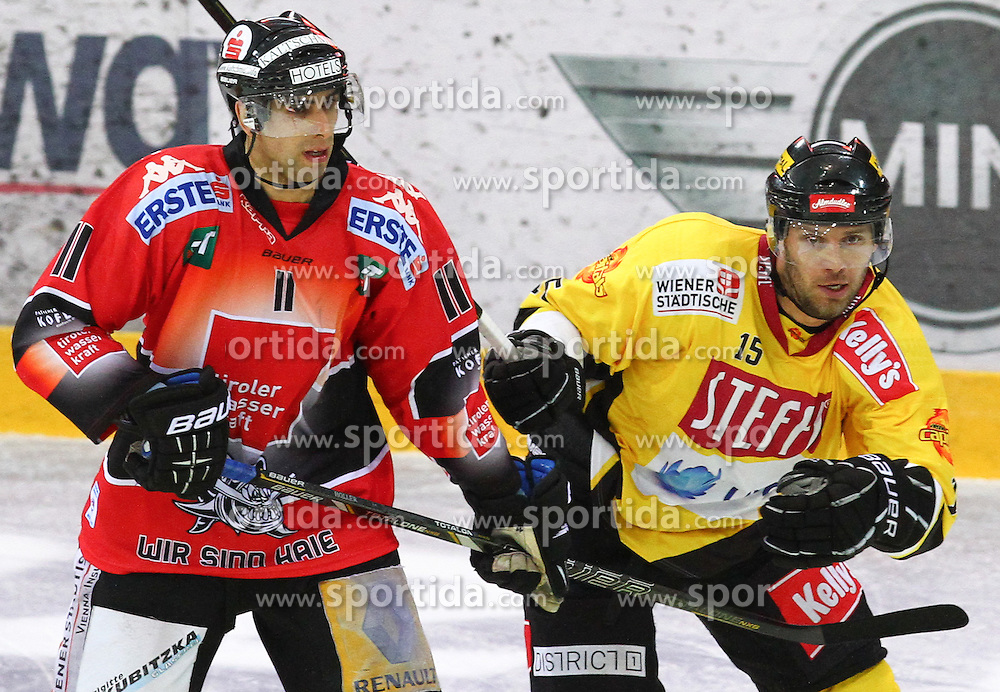 21.09.2012, Albert Schultz Eishalle, Wien, AUT, EBEL, UPC Vienna Capitals vs HC TWK Innsbruck, 5. Runde, im Bild Alexander Hoeller, (HC TWK Innsbruck, #11) und Francoise Fortier, (UPC Vienna Capitals, #15)  // during the Erste Bank Icehockey League 5th Round match betweeen UPC Vienna Capitals and HC TWK Innsbruck at the Albert Schultz Ice Arena, Vienna, Austria on 2012/09/21. EXPA Pictures © 2012, PhotoCredit: EXPA/ Thomas Haumer