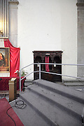 stage in church blocking a confessional, Duomo, Città di Castello, Umbria, Italy