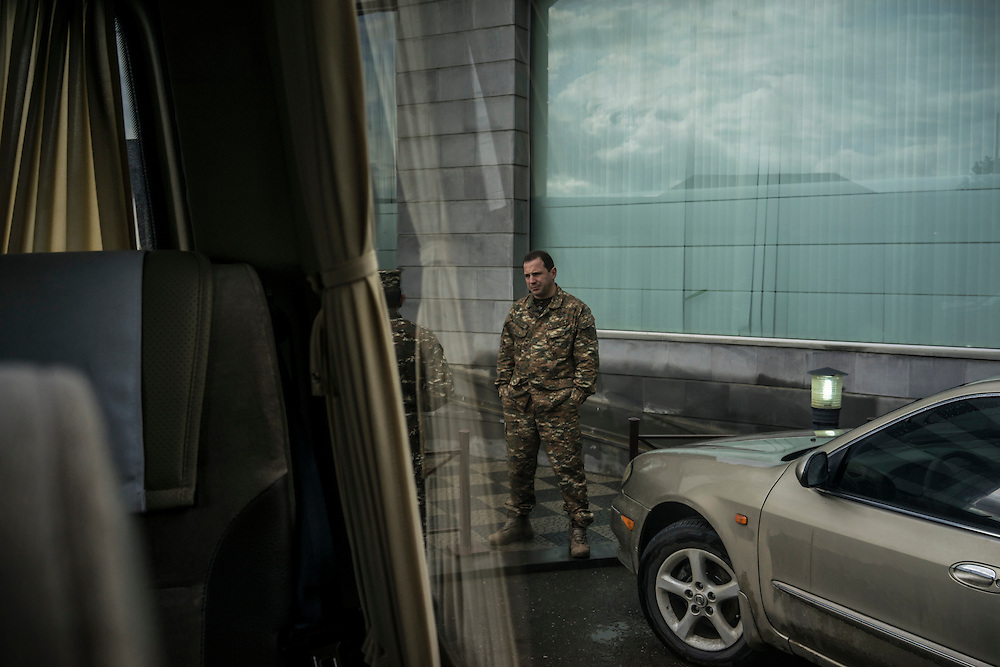 Military officials viewed from a van window before a trip with foreign journalists to the front lines on Sunday, May 8, 2016 in Stepanakert, Nagorno-Karabakh.