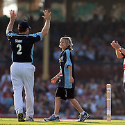 Aiden Buchanan, 13, from Victioria who lost his sister, brother and Uncle in the Victorian bushfires  dismisses Steve Waugh with his bowling and is congratulated by Michael Slater and Sir Michael Parkinson during Australia's Big Bash Cricket match to raise money for the Victorian Bushfire Appeal at the Sydney Cricket Ground, Sydney, Australia on February 22, 2009. The match was attended by over 20,000 spectators. Photo Tim Clayton