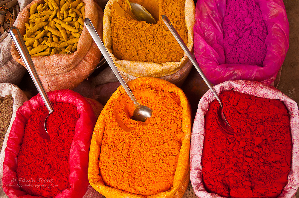 Large bags of colorful spices are displayed in a market in Jamkhed, India.