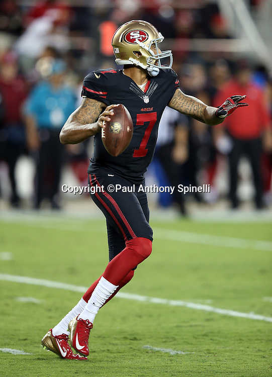 San Francisco 49ers quarterback Colin Kaepernick (7) rolls right and throws for a first down on the Niners first drive during the 2015 NFL week 1 regular season football game against the Minnesota Vikings on Monday, Sept. 14, 2015 in Santa Clara, Calif. The 49ers won the game 20-3. (©Paul Anthony Spinelli)