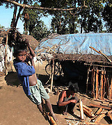 "kanu Baske, an adibashi Santhal child is playing near his temporary shelter without proper education, food and medical facilities in a refugee camp at Bodo Territorial Council And Districts (BTAD) area, about 268 kilometers southwest of Guwahati, capital of northeastern Indian state of Assam, Sunday, June 19, 2005, after the ethnic-cleansing between the Adibashi and Bodo clans on 1996, while the worlds will celebrate ""WORLD REFUGEE DAY"" on 20th June, 2005. (AFP Photo/Shib Shankar Chatterjee)"