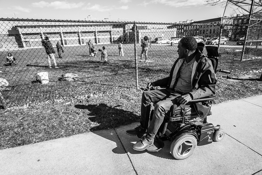 BALTIMORE, MD -- 3/2/16 -- Van Brooks runs the Safe Alternative Center, which he started to give middle school kids in West Baltimore a safe place to learn and play. <br /> <br /> Brooks was a Division 1 prospect when he played football in high school, but was paralyzed in a freak accident after making a tackle in his junior year. He regained the use of his arms, even walking again with much assistance, and graduated on time from high school. He later earned a degree in marketing from Towson University. Though still confined to a wheelchair, he is self-sufficient and runs the center.&hellip;by Andr&eacute; Chung #_AC13500