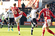 Michael Dawson wins the ball from Matthew Pearson (6) during the EFL Sky Bet Championship match between Nottingham Forest and Luton Town at the City Ground, Nottingham, England on 19 January 2020.