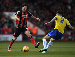Bournemouth's Charlie Daniels in action against Huddersfield Town's David Edgar - Photo mandatory by-line: Paul Knight/JMP - Mobile: 07966 386802 - 14/02/2015 - SPORT - Football - Bournemouth - Goldsands Stadium - AFC Bournemouth v Huddersfield Town - Sky Bet Championship