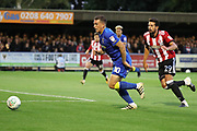 AFC Wimbledon striker Cody McDonald (10) beating Brentford defender Yoann Barbet (29) and dribbling into the box during the EFL Cup match between AFC Wimbledon and Brentford at the Cherry Red Records Stadium, Kingston, England on 8 August 2017. Photo by Matthew Redman.