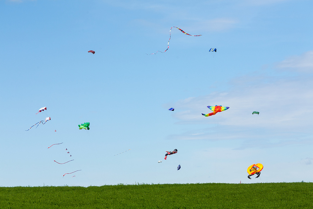 Huge kites loft gently in the stiff morning winds. It's like looking into an acquarium, without the glass. Windscape Kite Festival, Swift Current, Saskatchewan.