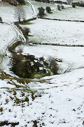 © Licensed to London News Pictures. 27/04/2016. Builth Wells, Powys, Wales, UK. Some of the high land of Powys is covered by light snowfalls which arrive from frequent storm clouds. Photo credit: Graham M. Lawrence/LNP