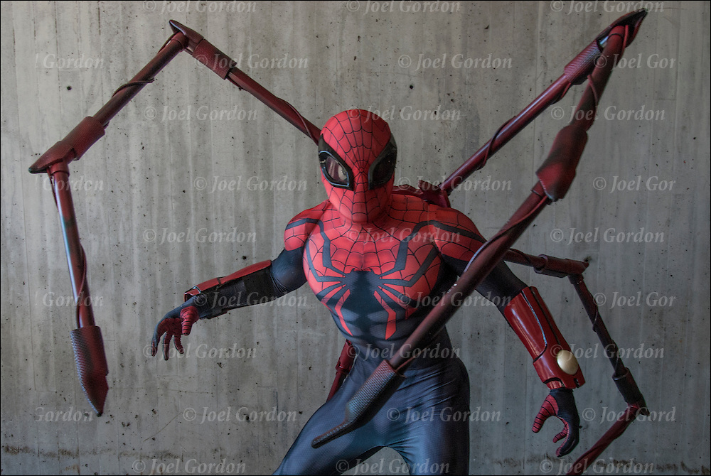 Cosplay attendee in his Spider Man costume.  Spider-Man is a fictional superhero appearing in Marvel Comics. <br /> <br /> The New York Comic Con convention, is a celebration of comic books, graphic novels, sci-fi and video games, toys, movies and television.<br /> <br /> More than 150,000 people attended the event dressed up as their favorite superhero to celebrate comic books, sci-fi and video games.<br /> <br /> The convention brings together celebrities as well as fans of fantasy role playing, Comic-Con is the business of pop culture.
