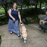 ARLINGTON, VA -JUNE3:  Tiffany Jolliff walks with her assistance dog, Railey, outside her apartment in Arlington, VA, June 3, 2016. The Washington Lawyers' Committee for Civil Rights and Urban Affairs filed a lawsuit Thursday in federal district court in the Eastern District of Virginia on behalf of Tiffany Jolliff against Uber, alleging violations of the Americans With Disabilities Act and the Virginians with Disabilities Act, alleging Uber unlawfully refused to accommodate Jolliff, who is blind, and her service dog, Railey. The complaint alleges that Jolliff, who works as a policy specialist for the federal government on employment for workers with disabilities, has been repeatedly discriminated against and denied Uber's services when Uber's drivers have seen that she is accompanied by her service dog Railey. Specifically, instead of accommodating her service dog Railey, as both the ADA and VDA require, Uber drivers have repeatedly driven off upon seeing that Ms. Jolliff had a service dog. (Photo by Evelyn Hockstein/For The Washington Post)