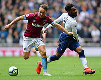 Football - 2018 / 2019 Premier League - Tottenham Hotspur vs. West Ham United<br /> <br /> West Ham United's Mark Noble holds off the challenge from Tottenham Hotspur's Danny Rose, at The Tottenham Hotspur Stadium.<br /> <br /> COLORSPORT/ASHLEY WESTERN