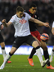 Derby Craig Forsyth battles with Reading Nick Blackman, Derby County v Reading, FA Cup 5th Round, The Ipro Stadium, Saturday 14th Febuary 2015