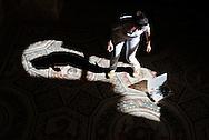 Piazza Armerina, Sicilia - 22 giugno 2012. Una restauratrice pulisce un mosaico all'interno della Villa Romana del Casale a Piazza Armerina. Il sito archologico, di epoca romana e patrimonio dell'Unesco, custodisce al suo interno esempi di mosaici tra i più importanti al mondo..Ph. Roberto Salomone Ag. Controluce.ITALY - A restorer at work inside the roman archeological site of Villa Romana del Casale in Piazza Armerina (Sicily) on June 22, 2012. The world heritage archological site preserves some of the most beautiful mosaics of roman age.